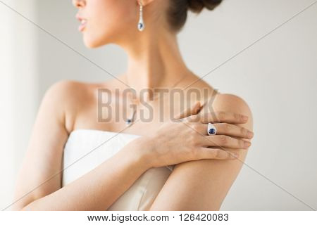 glamour, beauty, jewelry and luxury concept - close up of beautiful woman with finger ring