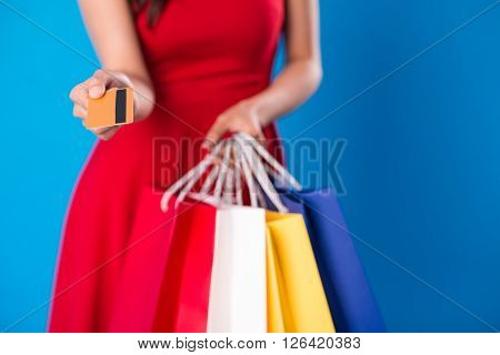 Female shopaholic giving you credit card, selective focus ** Note: Shallow depth of field