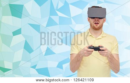 3d technology, virtual reality, entertainment and people concept - happy young man with virtual reality headset or 3d glasses playing with game controller gamepad over low poly background
