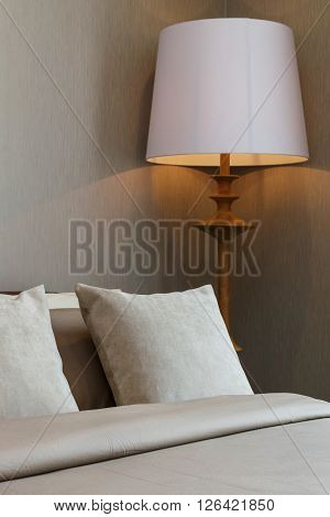 Classic Bedroom With Wooden Lamp And Pillows