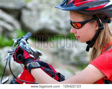 Bikes cycling girl. Bicyclist girl watch on smart watch.