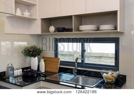 Ceramic kitchenware on the marble worktop and shelf