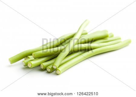Sweet gummy sticks with green apple flavor. Tasty candies isolated on white background.