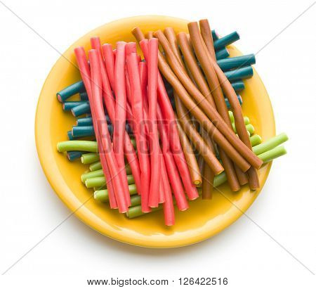 Sweet gummy sticks with different flavors. Tasty fruity candies on white background.