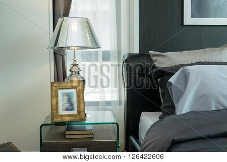 Luxury Lamp And Picture Frame On Bedside Table In Bedroom