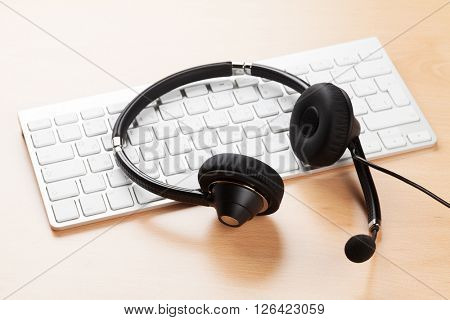 Office desk with headset and pc. Call center support table