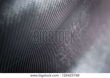 Abstract dark backgroud shallow depth of field carbon fiber texture