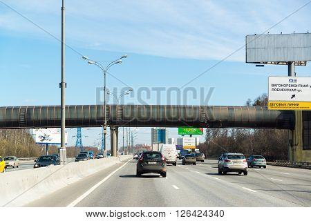 Moscow, Russia - April 08.2016. Overhead footbridge crossing over Moscow Ring Road.