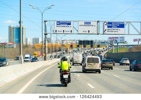 Moscow, Russia - April 08.2016. Motorcyclist in the left lane on Moscow Ring Road.