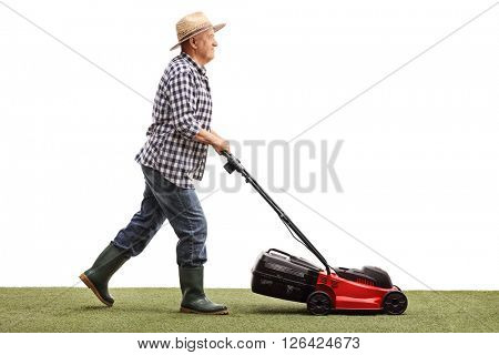 Profile shot of a mature gardener mowing a lawn with a lawnmower isolated on white background