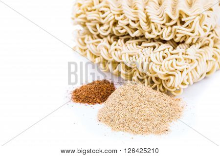 Unhealthy Flavoring Powder With Uncooked Instant Noodles In Background