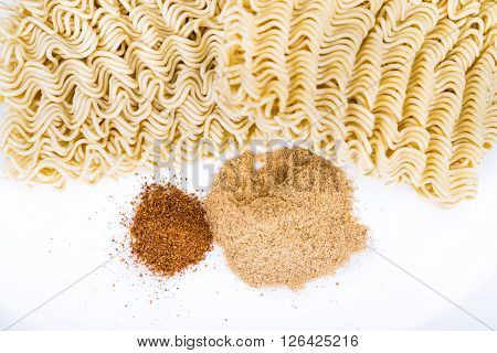 Closeup On Unhealthy Flavoring Powder With Uncooked Instant Noodles
