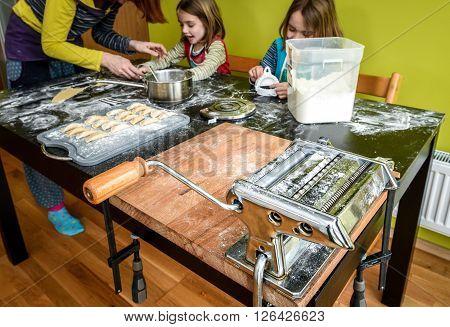 Family Is Making Home Made Pastry Dumplings Tortellini Or Ravioli