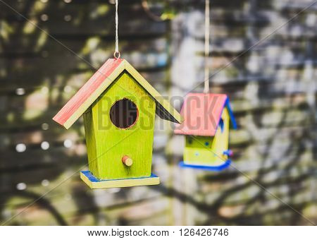 Two Old Weathered Diy Birdhouses Hanging From The Tree