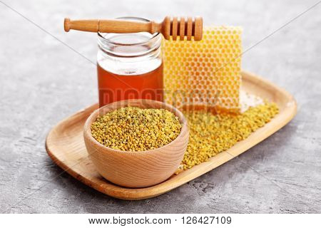 bowl full of bee pollen with honey comb - sweet food