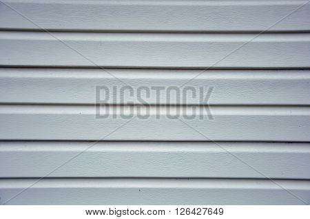 beige plastic panel siding for lining the outer walls of the house horizontal texture