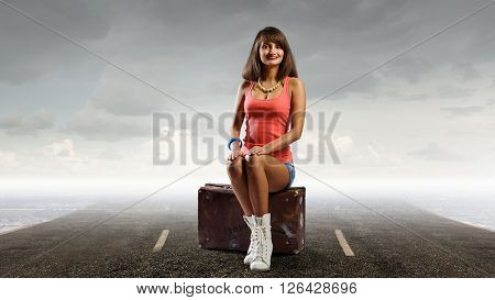 Pretty brunette retro hitchhiker