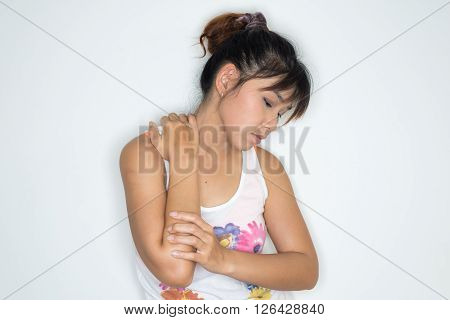 Exercise series : Asian woman grabs her shoulder, presenting shoulder pain