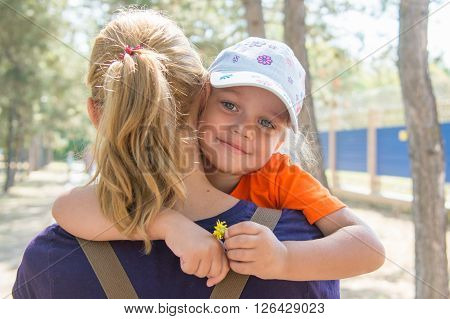Pretty Little Girl Is Looking Through My Mothers Shoulder While Sitting In Her Arms