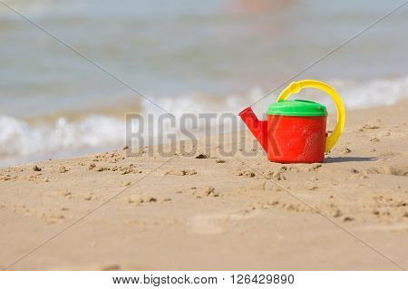 Children Head Left On The Shore Of The Beach Near The Water