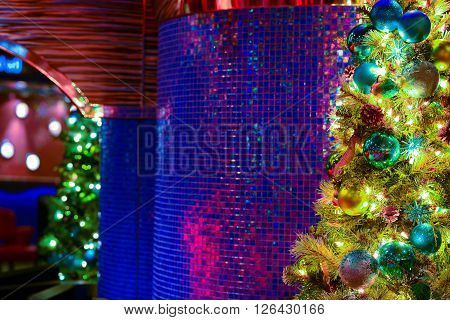 Christmas decorations hanging on poles in natural light
