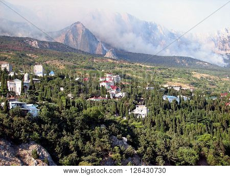 Holiday on Black Sea Simeiz in july when the forest on the mountain Ai-Petri is on the fire