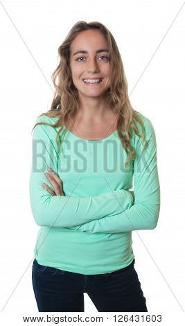 Laughing blonde caucasian woman with blue eyes and crossed arms on an isolated white background for cut out