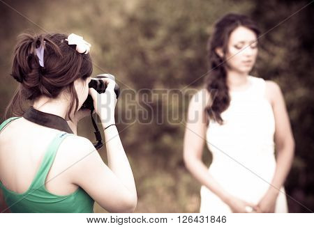 Picture of a woman photographer making a photo of a bride