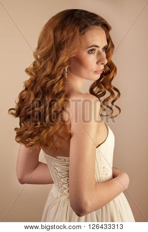 Picture of beautiful bride wedding dress and curly hairstyle