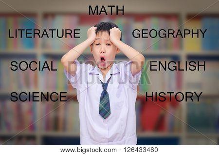 Young asian boy screaming in school classroom