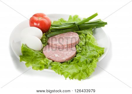 Picture of onion eggs ham tomato on white plate