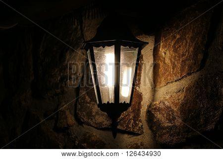 Retro lamp on stone wall at night