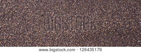 Close up of dark sand texture, sand background