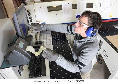 Carpenter in front of a cutting machine