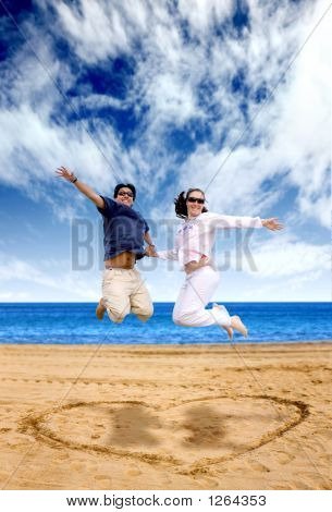 Beach Couple Having Fun - Jumping