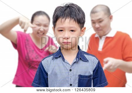 Young asian boy crying between his parent scold him