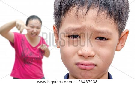 Young Asian crying between mother scold him
