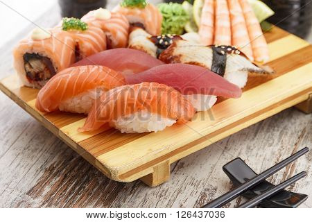 Japanese Cuisine. Sushi Set On A Wooden Plate (gete) With Chopsticks Over Rustic Table.