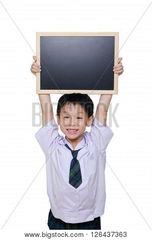 Young asian schoolboy holding chalkboard over white