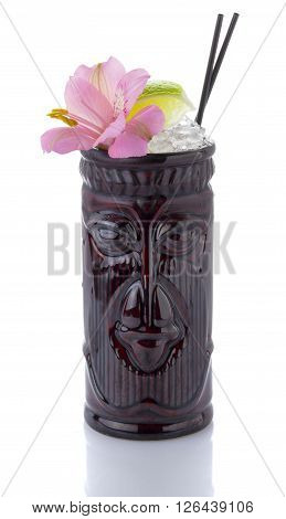 Tropical Cocktail Served In A Tiki Style Glass And Garnished With Fruits Isolated On White Backgroun