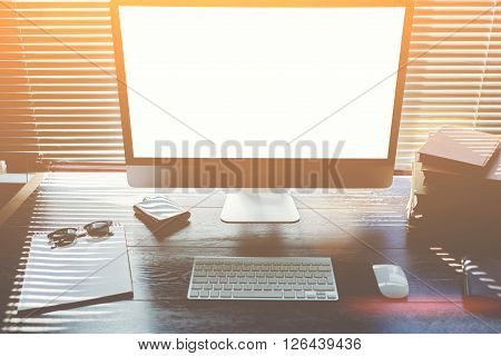 Mock up of office desktop with accessories and work tools pc computer with blank copy space screen for your promotional contentkeyboard with mousesunglassesclear notepad modern hipster work space