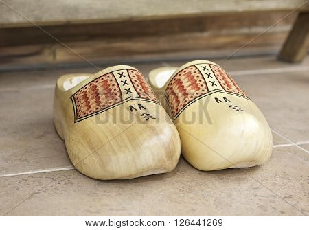 National traditional Holland shoes clogs, Bright yellow wooden clogs, traditional Holland's shoes