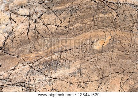 Stone texture. Portrait of a red stone. Horizontal image.