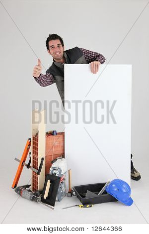 Worker with thumb up near a white sign