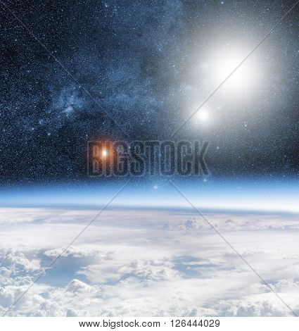 Earth horizon with starry background and nebulosity.