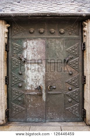 Massive old door in courtyard of famous Saint Stephen's cathedral in Passau Germany. Architectural element.