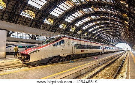 Milan, Italy - May 8, 2014: New Pendolino high-speed tilting train at Milano Centrale railway station. This train is owned by SBB CFF FFS - Swiss Federal Railways