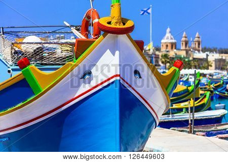 traditional colorful fishing boats luzzu un Malta
