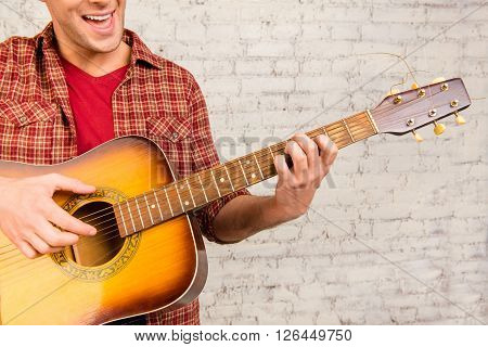 Close Up Portrait Of  Cheerful Man Playing On The Guitar And Singing
