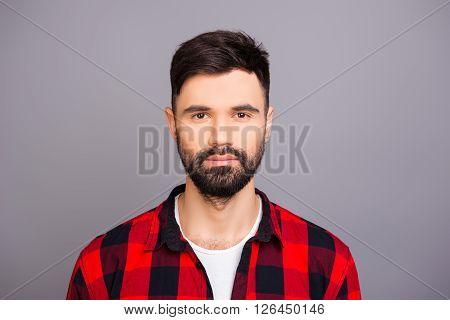 Portrait Of Serious Brutal Man On Gray Background